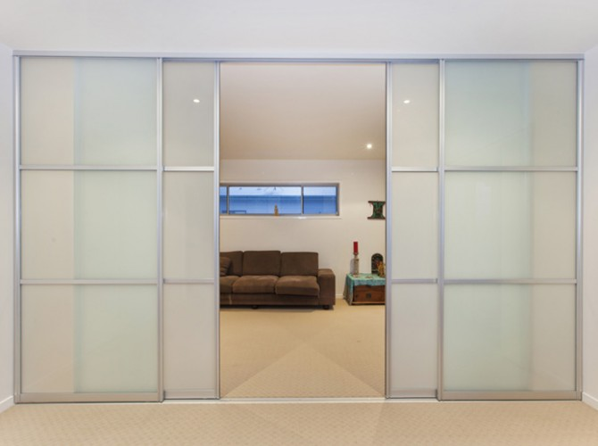 Glass room divider interior sliding doors customcote glass for Sliding doors interior room divider